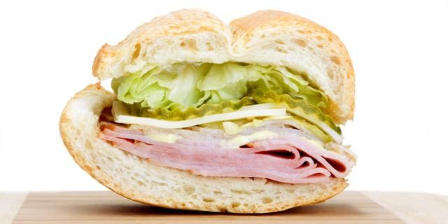 Cuban Sandwich: This version of the popular sandwich is a combination of turkey, roast pork, ham, and Swiss cheese, piled high on Cuban bread and pressed with a sandwich iron until the bread is hot and crispy and the cheese has slightly melted.