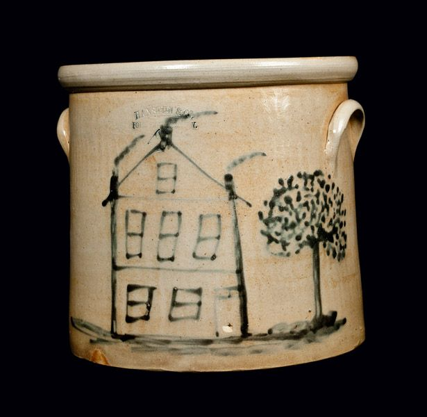 """Price Realized: $ 2,300.00 Outstanding Four-Gallon Stoneware Crock with Cobalt House Decoration, Stamped """"HAXSTUN & CO. / FORT EDWARD, N.Y.,"""" circa 1880, cylindrical crock with semi-rounded rim and applied lug handles, decorated with a folky slip-trailed design of a three-story with six windows, a door with dormer, and three chimney billowing with smoke. House is situated on a lawn with large tree to the right. Excellent and visually-striking decoration."""