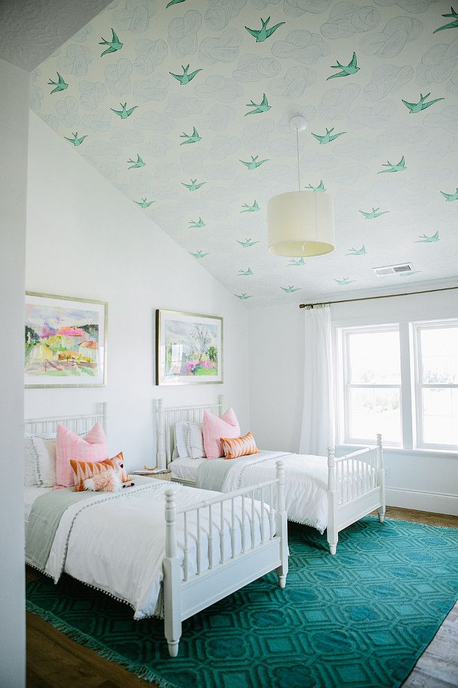 pretty twin beds and swallow wallpaper on ceiling