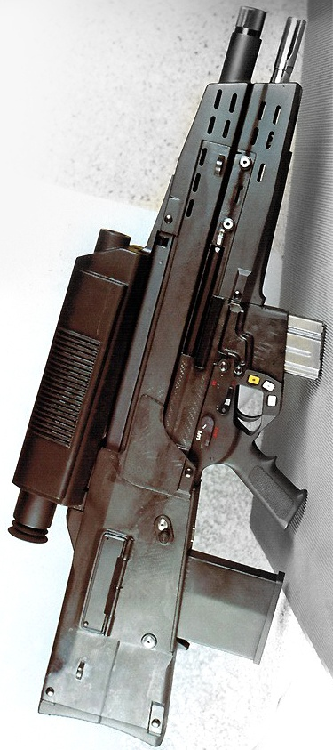 The HK OICW KE Phase III had High Explosive ammunition firing from the top barrel and Kinetic Energy rounds accurate up to 1,000 meters firing from the lower.