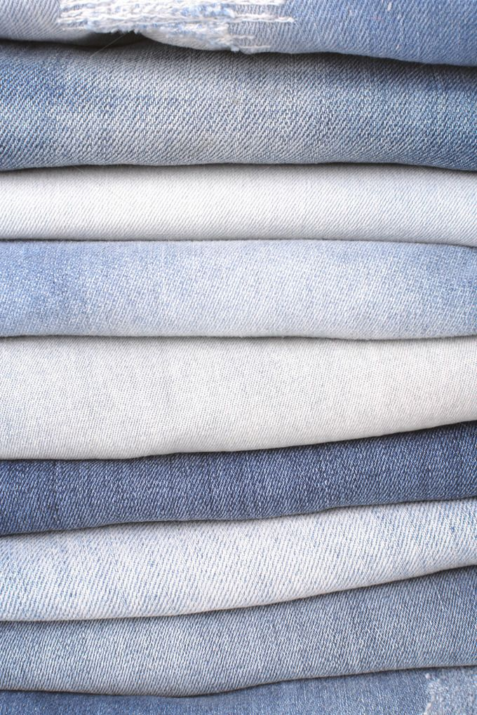 Stack of folded jeans by studio1901 on @creativemarket