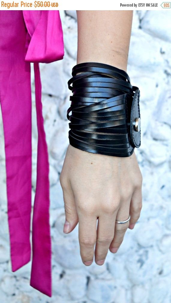 Genuine leather bracelet, extravagant and fun to wear, versatile and playful. Double wrap bracelet. Be the urban muse of today! Material: 100% genuine leather  The pink top in the photos: https://www.etsy.com/listing/508576621/extravagant-pink-top-asymmetrical-pink