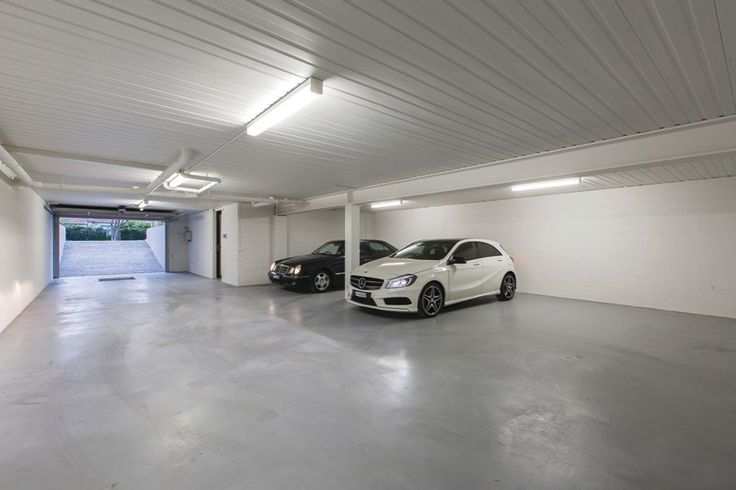 Car garage underground under house house exterior Garage under house