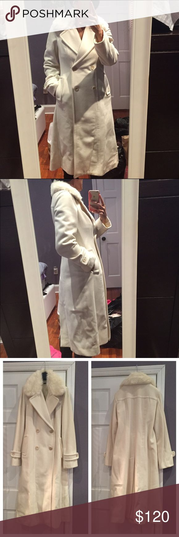 """Benetton wool coat Like new Benetton wool coat in cream color. Beautiful coat that was only worn a couple of times. Bottom needs some pressing due to storage. No rips or tears and only small spot I saw was on the front. Barely noticeable though (see pic). Detachable fur collar. Measures 44"""" in length. Size 42 but fits like an 8. United Colors Of Benetton Jackets & Coats"""
