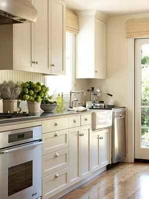 Off-white cabinets, dark countertop
