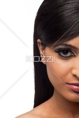 half face of a beautiful young female. - Portrait shot of half face of a beautiful young female over white background.