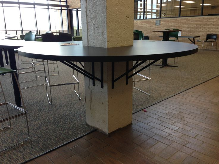 Counter is built around column in open use area of edina for When did table 52 open