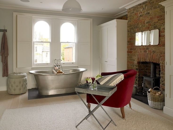 Wimbledon Residence by Leivars. Used brick, lots of white with soft blue and a deep red color pop.
