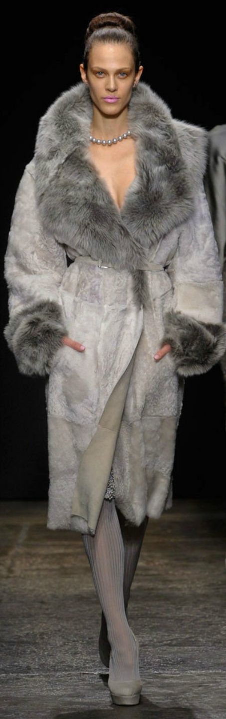 Donna Karan. Is this real fur? If so I wonder how many animals were SKINNED ALIVE to make this coat so a human could wear their skin? Yes, skinned alive. That is how is done. Even some 'faux fur' is actually dog fur and the dogs are skinned alive as well.