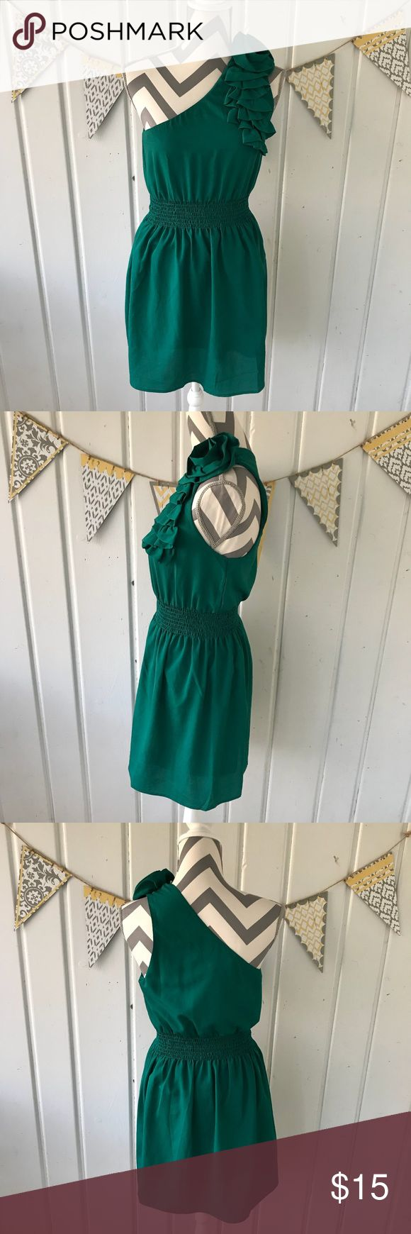 "Forever 21 One Shoulder Green Mini Dress Adorable one shoulder dress from Forever 21. It is in very good condition. Features a floral ruffle on the shoulder. Perfect to wear to a summer wedding. Approximately 34"" long Forever 21 Dresses One Shoulder"