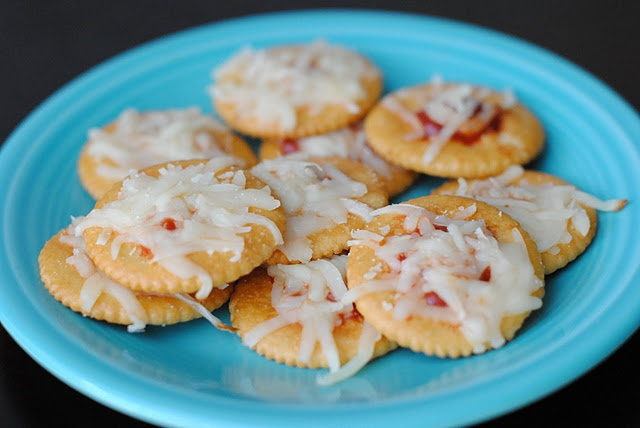 Mini pizzas made with Ritz crackers, pizza sauce, …