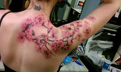 Cherry blossom tattoo by Andre Bernal at Death Before Dishonor in San Jose, CA.