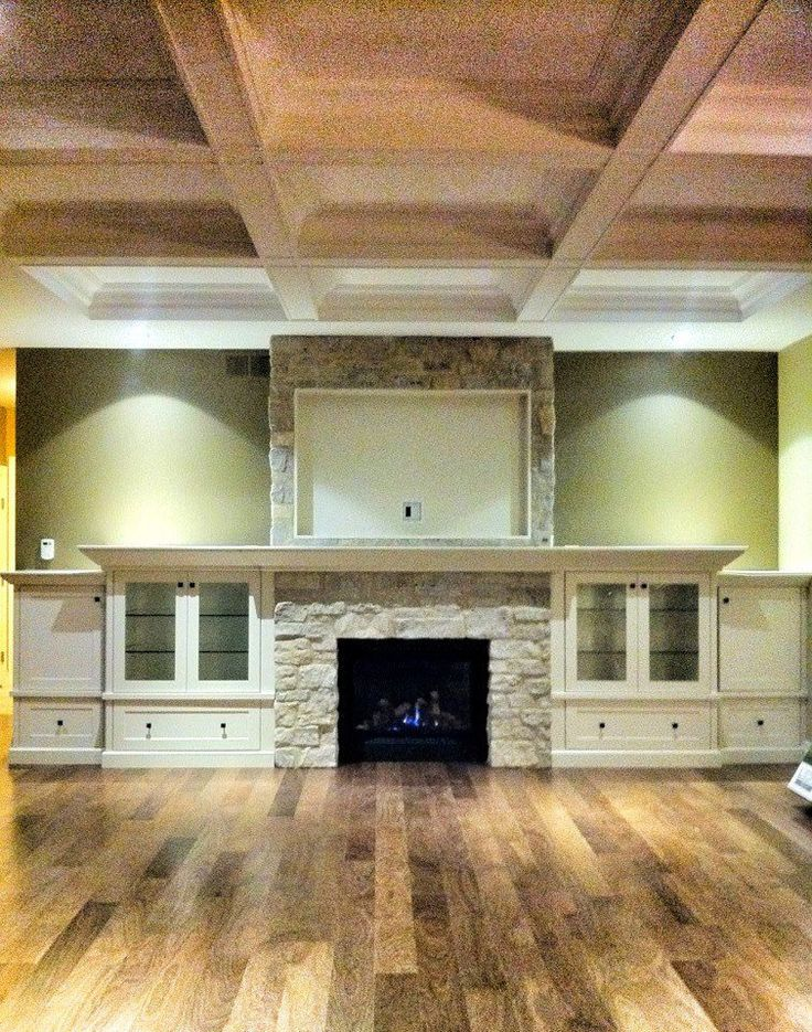 This turned out great!!!! Another happy customer!! Great storage space for a family room or great room. Beautiful white stone fireplace with built-in flat screen TV and green walls. Cant help mentioned the coffer ceilings