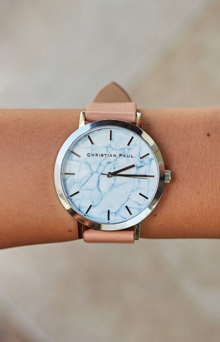 The traditional timepiece gets a modern makeover with the Christian Paul Silver And Nude Marble Watch. This piece embodies luxury, with its genuine leather band in nude, silver clasp and face border, and silver detail on the index and hands. The real stand-out is its sleek white round face complete with a blue marble background, making it one statement stunner you'll be wearing for years. Add a sophisticated touch to your everyday look with the Christian Paul Silver And Nude Marble Watch…