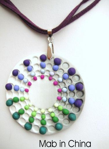 Polymer pendant by Mabcrea Art Cecilia Botton aka Ma-belette. Such a unique design!