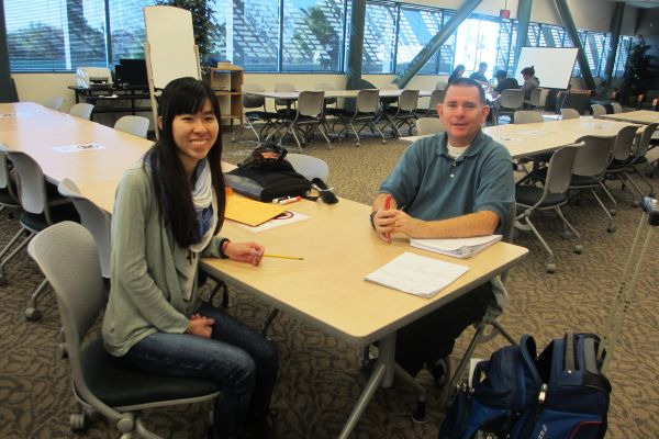 Thuy and Professor Bowen having a friendly discussion about upcoming Trigonometry tests on a Tuesday morning.