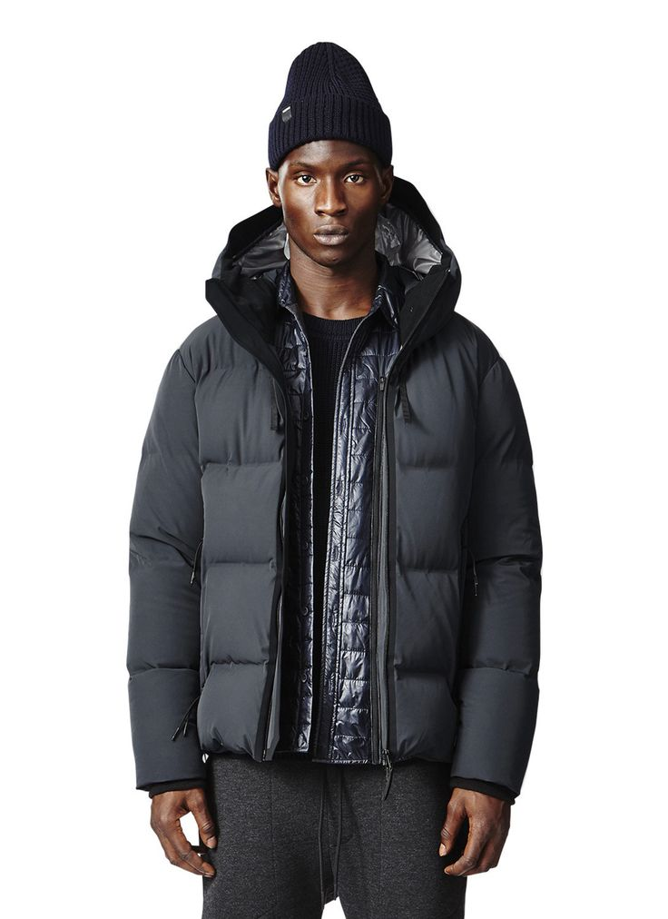 Made in a stretch 2L fabric using technical bonded construction, the down  channels of this hooded jacket are fused together, sans sewing, ...