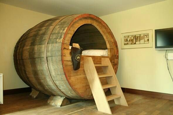 Best upcycle ever! I want to sleep in a massive wine barrel.