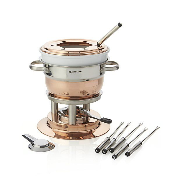 From one of Europe's finest housewares and cookware companies, this elevated, multipurpose fondue set attracts with the warmth of copper and the versatility to easily prepare meat, cheese or chocolate fondue—from the classics to creative new variations. The 1.9-qt. copper-plated pot itself cooks oils for meat fondues, while the high-sided ceramic insert serves as a double boiler to keep delicate cheese and chocolate smooth and bubbly.