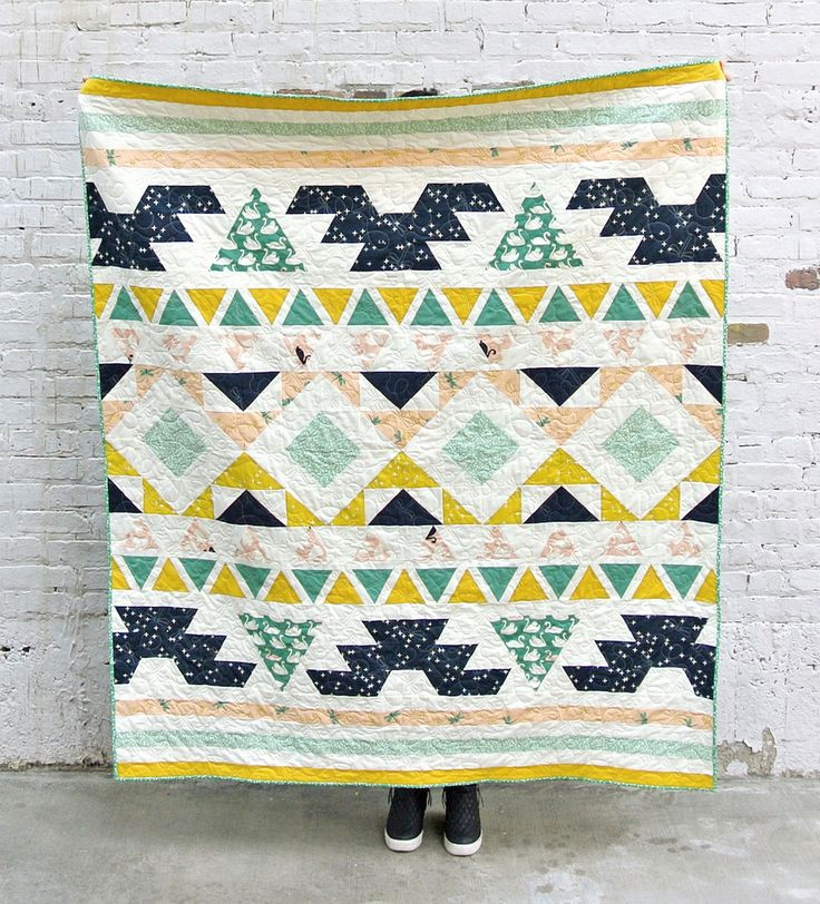 """The Warrior Quilt pattern by Suzy Williams of Suzy Quilts is the perfect modern twist for the much adored tribal pattern. The blocks are relatively simple and look amazing with Patrick and Andrea Patton's debut collection, Swan Lake, as well as Birch Fabric's Mod Basics 3 collection. These sweet little swans are to die for! Try your hand out at this beautiful Warrior Quilt.  Finished Size: 56"""" x 65.5""""  Seam allowance: 1/4""""  Kit includes the following:  -1/2 yards of the following prints…"""