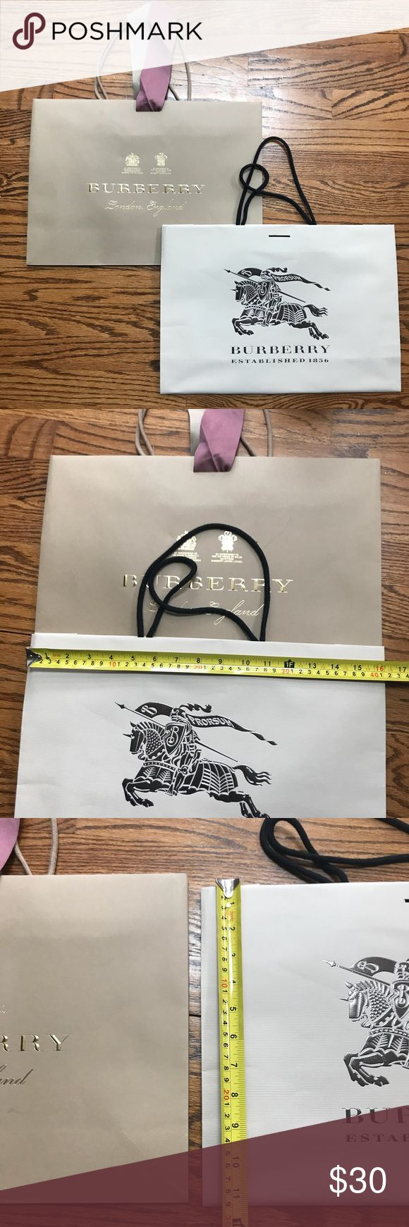 """Burberry shopping bags bundle Two authentic medium Burberry bags sizes 16""""x11.5"""" and a slightly taller one at 16""""x12"""". One bag is missing ribbon closure. Burberry Bags Travel Bags"""