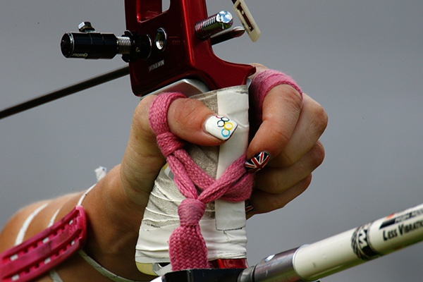 A detail view of the hand and nail varnish of Amy Oliver of Great Britain in action during the Women's Team Archery Eliminations match between Great Britain and Russia on Day 2 of the London 2012 Olympic Games at Lord's Cricket Ground on July 29, 2012 in London, England. (Photo by Paul Gilham/Getty Images)