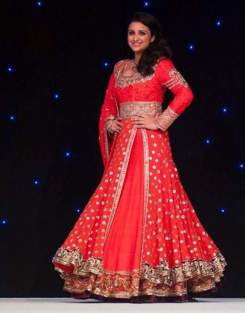 Red bridal lehnga on celebrity by Manish Malhotra via IndianWeddingSite.com