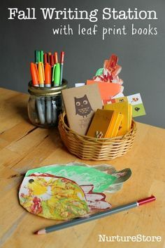 Fall writing station with leaf print books :: fall writing center ideas