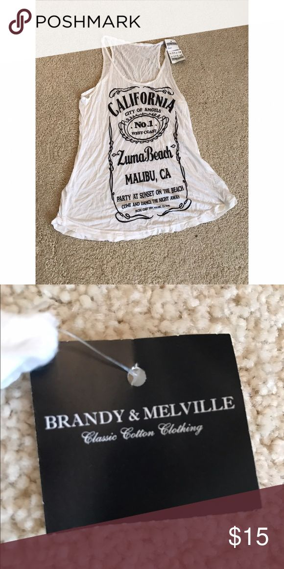 Brandy and Melville White Jack Daniels Tank NWT Brandy & Melville white Jack Daniela Tank Top. New with tags. One size fits all but it fits small. Brandy Melville Tops Tank Tops