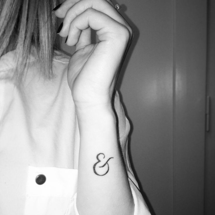 "My ampersand tattoo that stands for the relationship I have with my sister. We are twins and it will always be she ""&"" I."