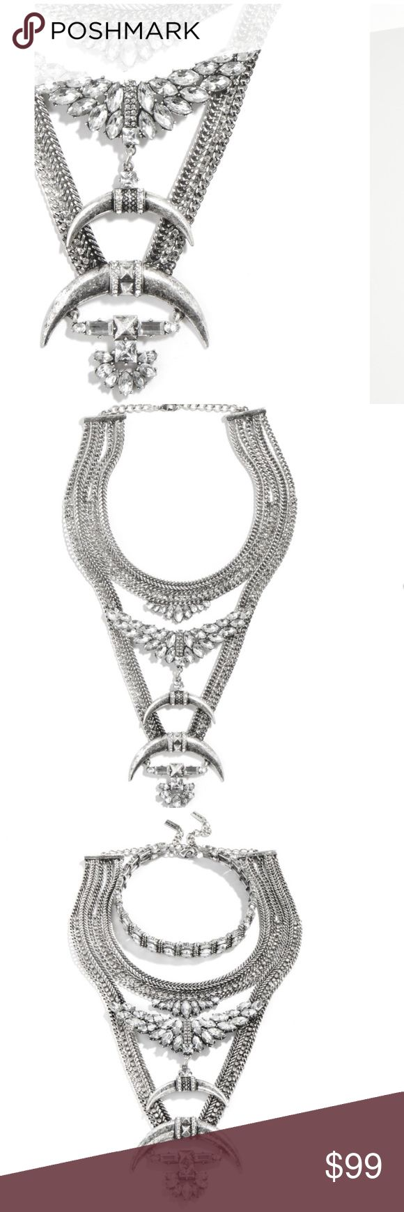 MADELHARI WARRIOR BIB Crescent pendants, glossy crystals and burnished chains make this warrior bib necklace anything but understated. Want to make this piece really stand out? Try styling it with t-shirts and neutral hues. Bonus points: Bib and choker can be worn separately for three looks in one. Jewelry Necklaces