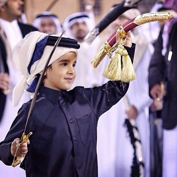 Cute Qatari kid preforming traditional Ard'a (sword dance ...