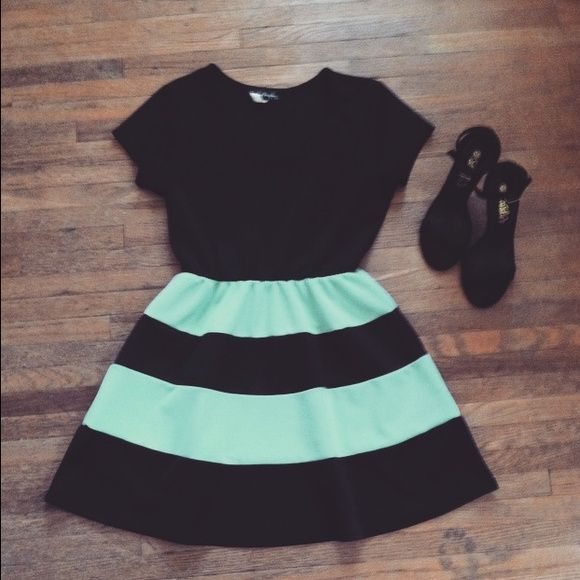 Mint/black tulle dress! Adorable stretching dress! Looks great on anyone! Good material not Tears or stains! Very soft with a silky feel! Absolutely adorable! Dresses Midi
