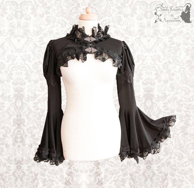 ➸ This black shrug is inspired by late Victorian fashion, adjusted to own design. It is made of a soft black stretch fabric, hemmed with lots of lace. It has decorative trim around the upper arm and the front closes with two silver tone metal clasps. ➸ I live in The Netherlands (EU), shipping outside the EU takes about 1-3 weeks from door to door. The item ships out within 1-3 days after purchase, priority & with tracking. If you need an item before a specific date, please contact me for…