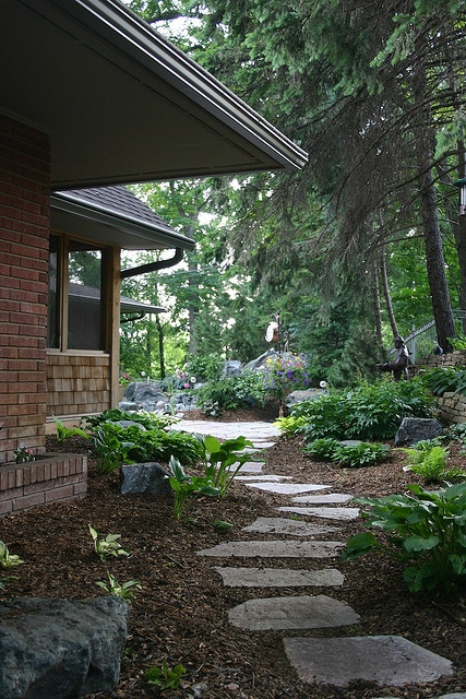 Flagstone path. Would love to do this out past the retaining wall on the forested part of the yard.