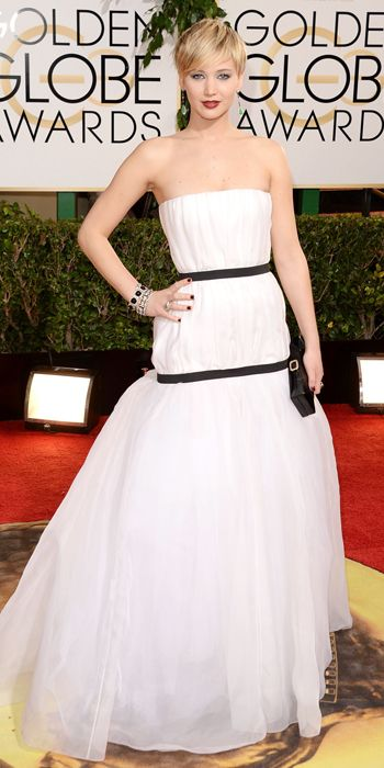 Graphic Black and White Gowns - Not surprisingly, Jennifer Lawrence wore a gathered, full-skirted dress by Dior that was punctuated by two black ribbon bands to cinch in the waist and hip, and a Roger Vivier clutch.