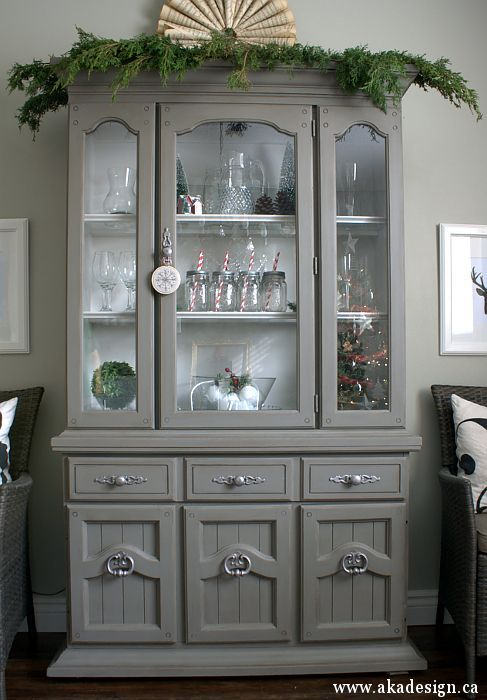 grey tweed hutch-- love the simple greenery on top of the hutch for Christmas!