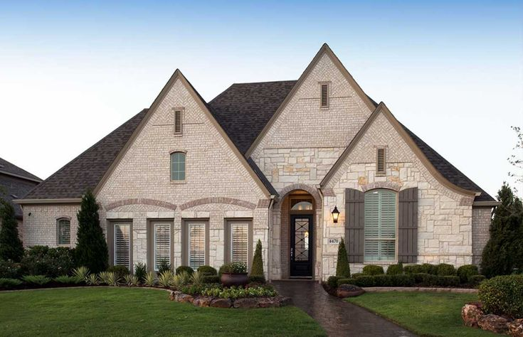 Exterior - Acme Alpine brick with Blanco Chopped stone (Chalked Blanco in photo).