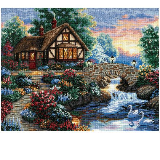 <div>This quaint little cottage looks so warm and inviting, even the swans wait to greet anyone ...