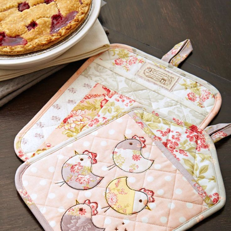 """Turn precut 10"""" squares into cute pot holders that make great gifts! Tuck a  recipe into the pot holder pocket to give the recipient culinary  inspiration.Fabrics are from the Whitewashed Cottage collection by 3  Sisters for Moda Fabrics [1].   [1] http://modafabrics.com"""