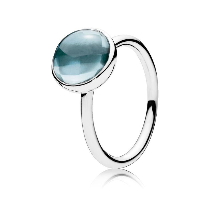 Infuse your look with a crisp, calming colour with this beautiful hand-finished ring by PANDORA. Set on sterling silver, the unique buff top cut of the dazzling aqua blue crystal makes the stone look water drenched and filled with light.