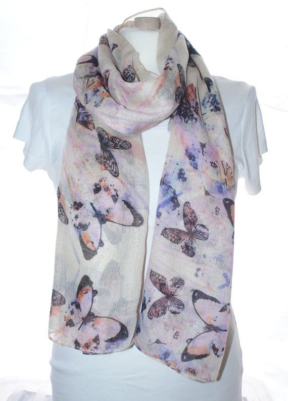 Ladies beautiful large butterfly print scarf. This scarf is light and soft may be worn as a beautiful scarf but very versatile and could also be worn