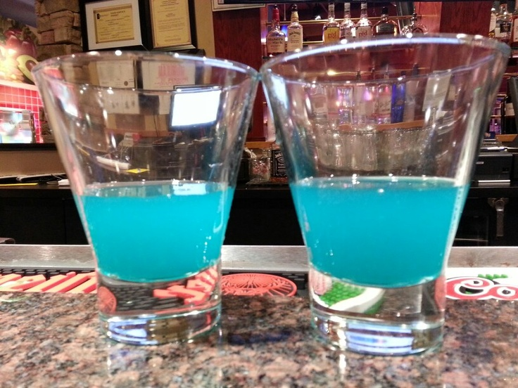Blue balls: Three Olives Loopy Vodka, blue curacoa, and pineapple. .. Caila's signature!