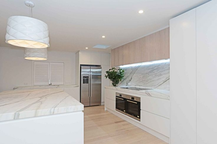 White satin lacquer bespoke kitchen designed by Jordan Dale from Gold Kitchens