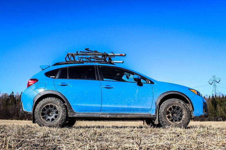 Brand:SubaruModel:CrosstrekYear:2016Color:Hyper Blue Modifications: Lift kit:LP AventureTires:215/75R15 BFGoodrichAll Terrain T/A KO2Wheels:Method Racing WheelsMR502 VTSpec 15x7 +15Cargo basket:Yakima LoadwarriorBike rack:Thule SidearmAccessories:Yakima Axe / Shovel bracket Without lift kit: With the lift kit: