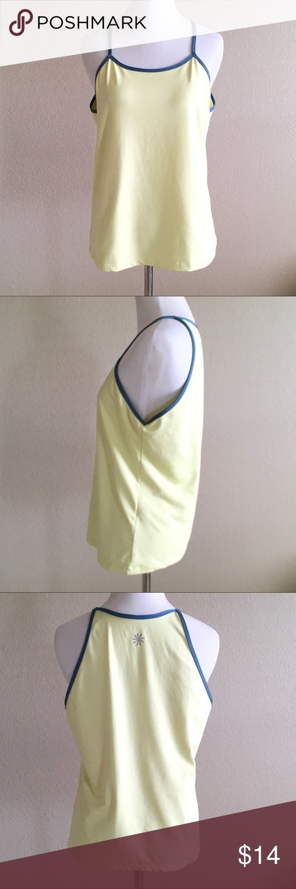 "Athleta EUC womens tank top ❤️Description: A pastel neon yellow top with smoky blue trim with no stains, rips, or flaws ❤️Condition: excellent used ❤️Brand: Athleta  ❤️Size:medium ❤️Color(s): yellow, blue ❤️Materials: 88% polyester 12% spandex ❤️Approximate Measurements, laying flat:       Waist  18""      Bust   17"" across the chest      Total length  24"" shoulder to bottom hem  ❤️Notes: 💕Bundle & save!💕 Athleta Tops Tank Tops"