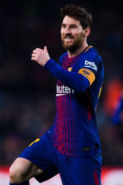 Lionel Messi of FC Barcelona celebrates after scoring his team's third goal during the La Liga match between Barcelona and Girona at Camp Nou on February 24, 2018 in Barcelona.