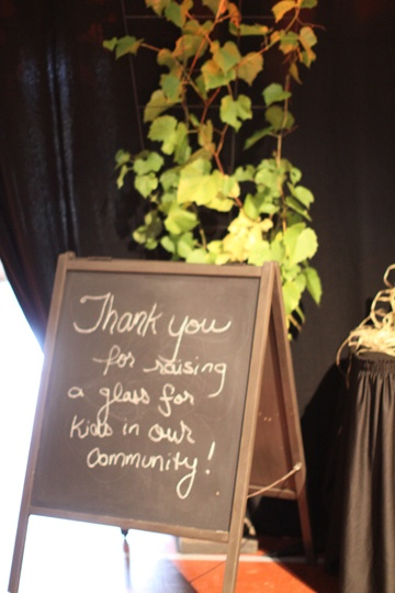 This smaller chalkboard flanking the entrance was a former crib headboard when we found it and repurposed it for the event.