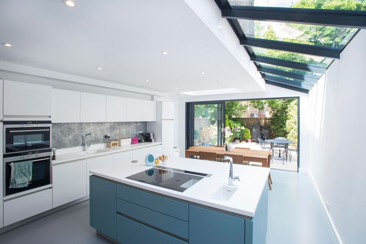 Side Return Extension on a Victorian Terraced House in Highbury, N5, Greater London, Sliding Glass Patio Doors, All-Glass Roof, Velux Roof Light, Flat Roof, L-Shaped Extension, Rear Kitchen Extension, Open Plan Design, Dining Room, Blue Kitchen, Blue Resin Flooring