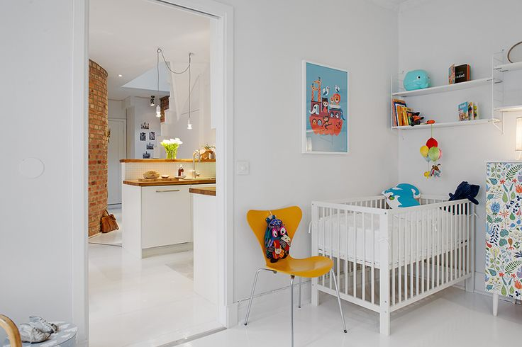 Some of today's most interesting nurseries celebrate the whimsical look of antique toys, incorporating them into more modern decor.